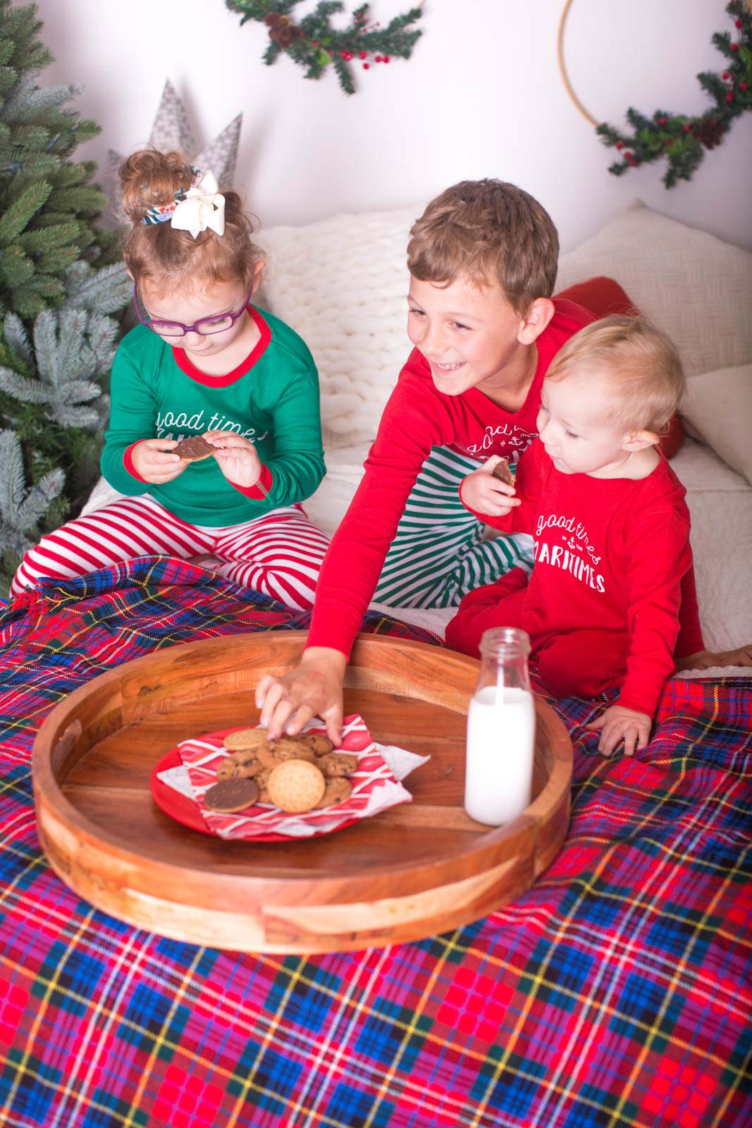 Image of 3 children eating cookies during Christmas milk and cookies session