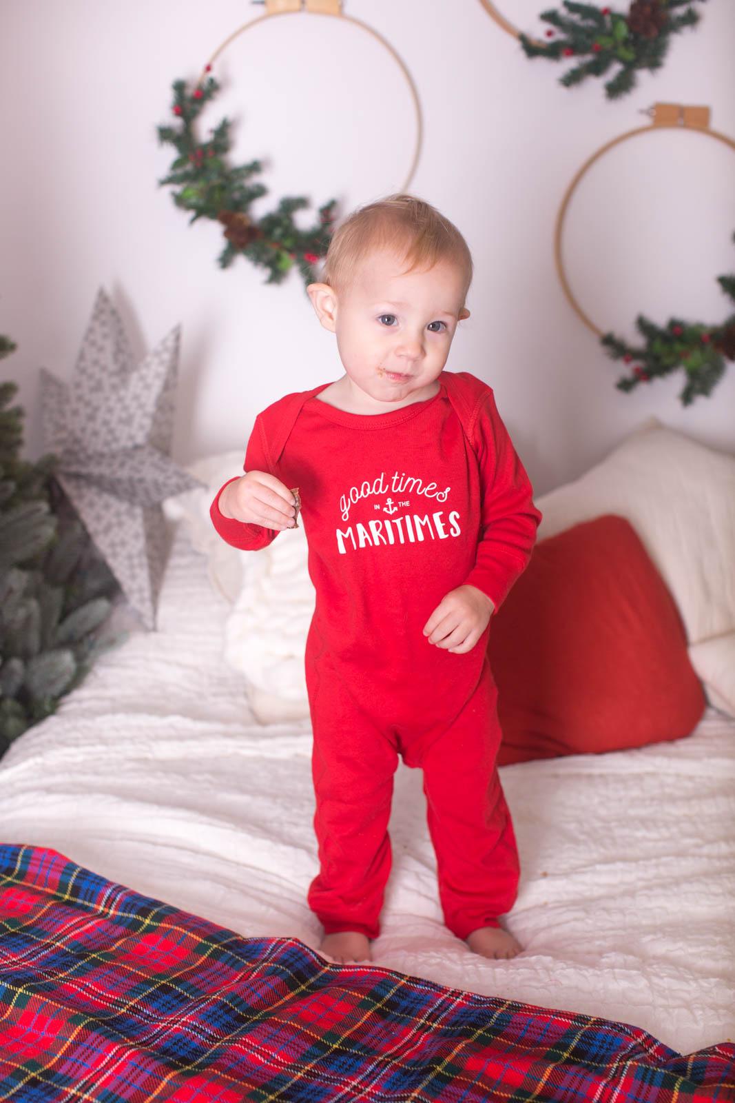 Image of boy on the bed wearing Christmas pyjamas