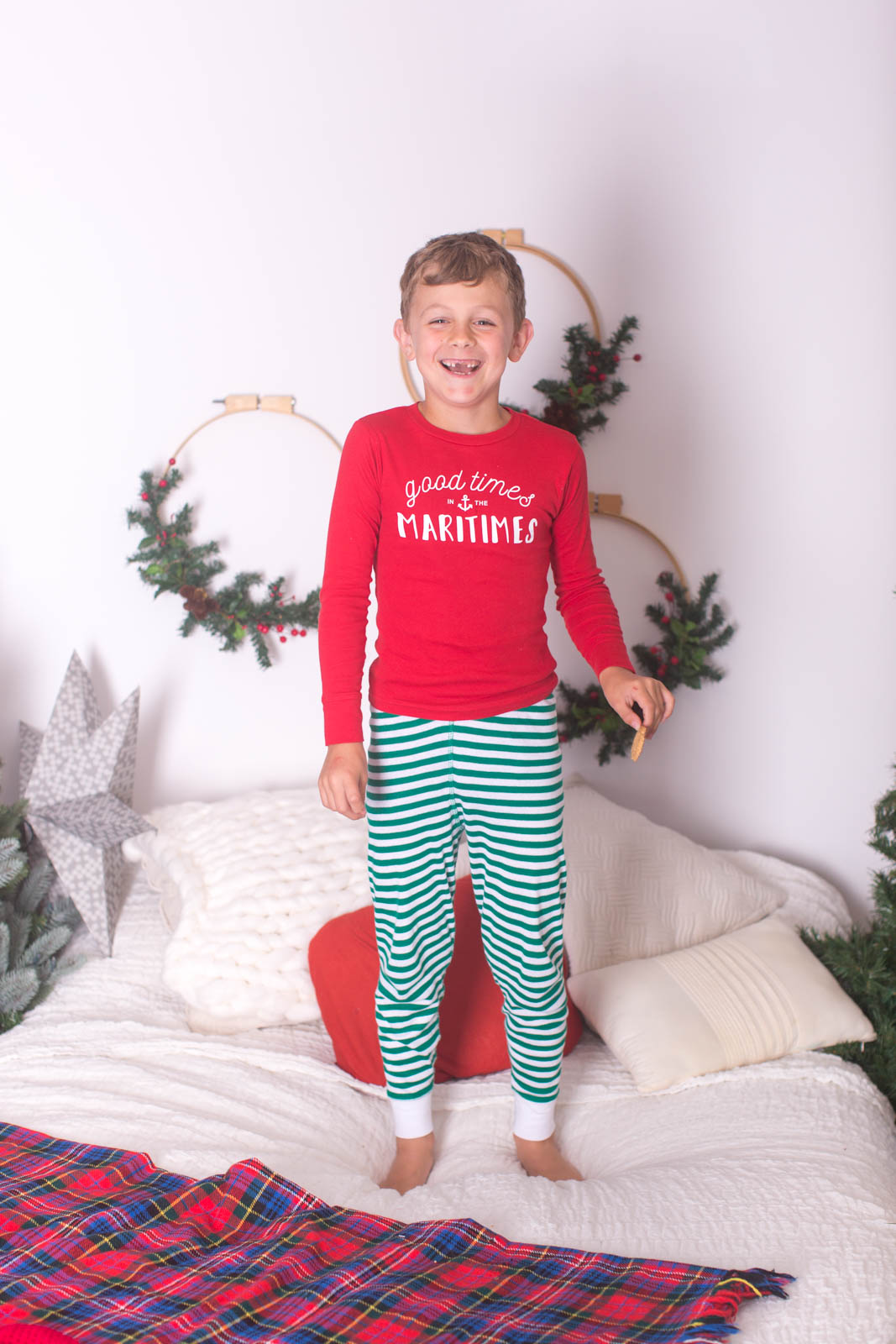 Image of boy laughing and jumping on the bed