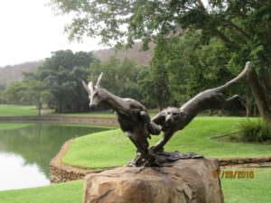 Metal statues greet golfers on each tee