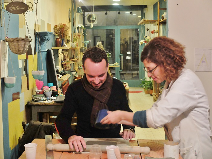 Nico and Anita making mugs in her shop on via romana