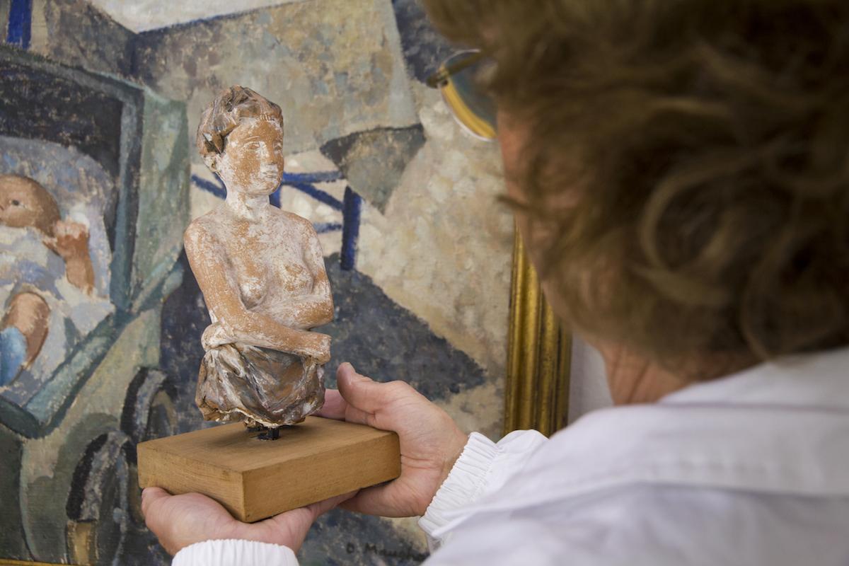 Restorer Rossella Lari, admires statue by artist Genni Mucchi,  against 'In the Garden'
