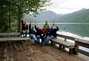 group of people in front of lake