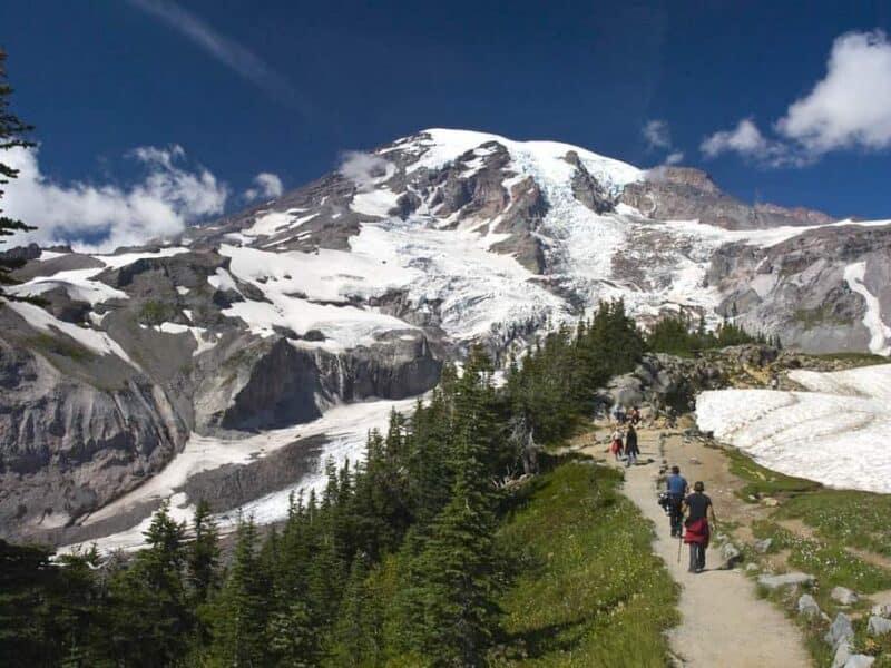 Tourists hiking Skyline Trail toward Mount Rainier