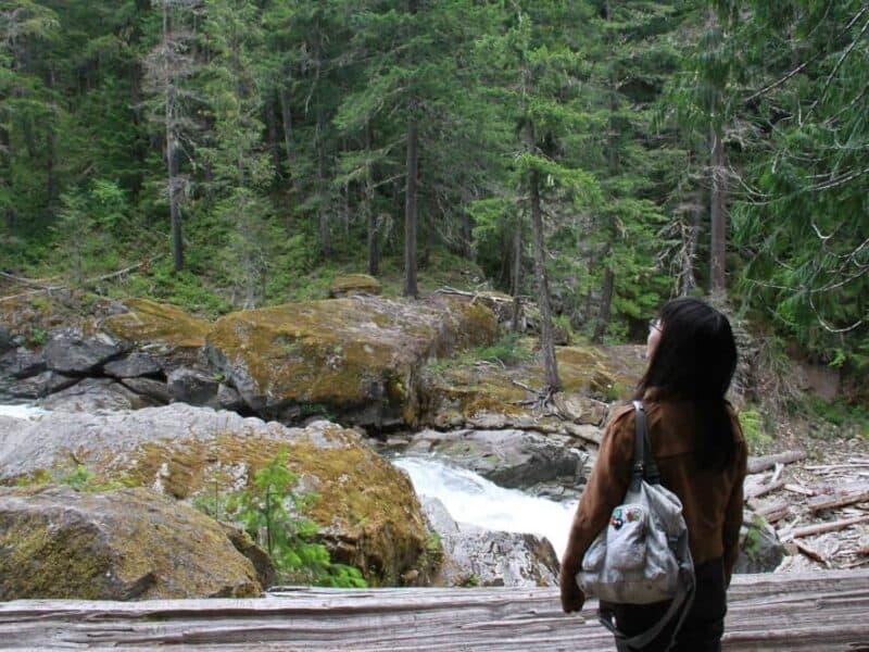 Woman hiking Mt. Rainier during Seattle tour
