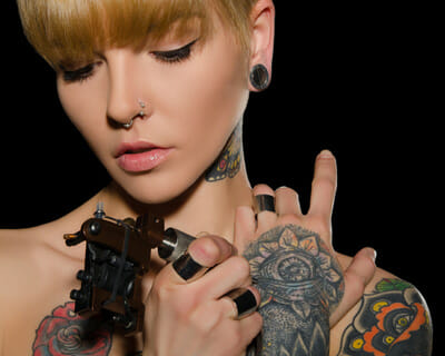 who invented the tattoo machine?