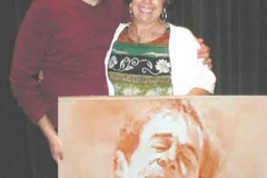 Mandy receiving his portrait, Ocean Reef, FL - Private Collection