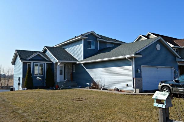 Blue sided house: Northface Construction