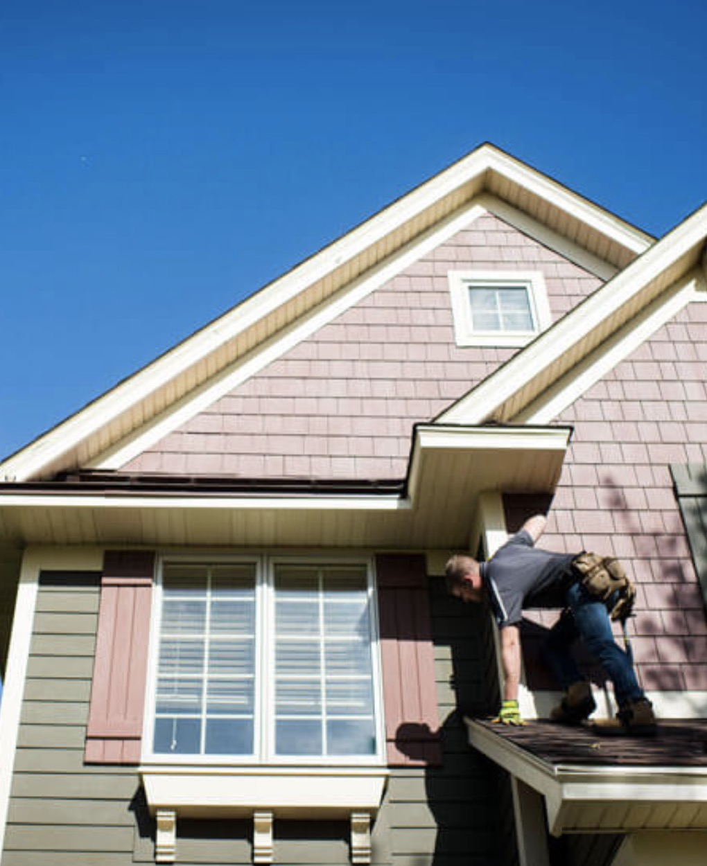 Roofer working on roof looking down