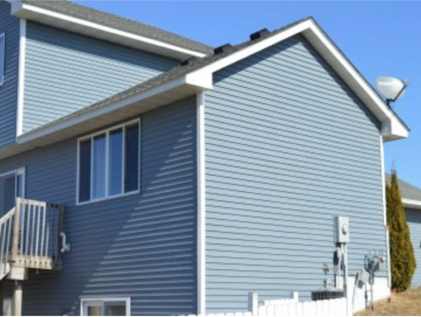Home with blue siding and grey roof