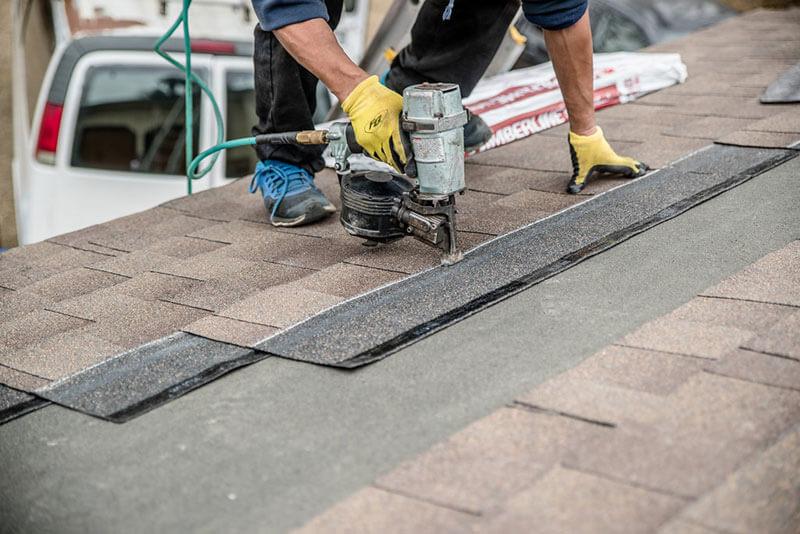 roof nail gun installing shingles