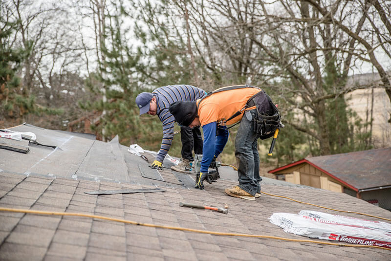 two men installing shingles