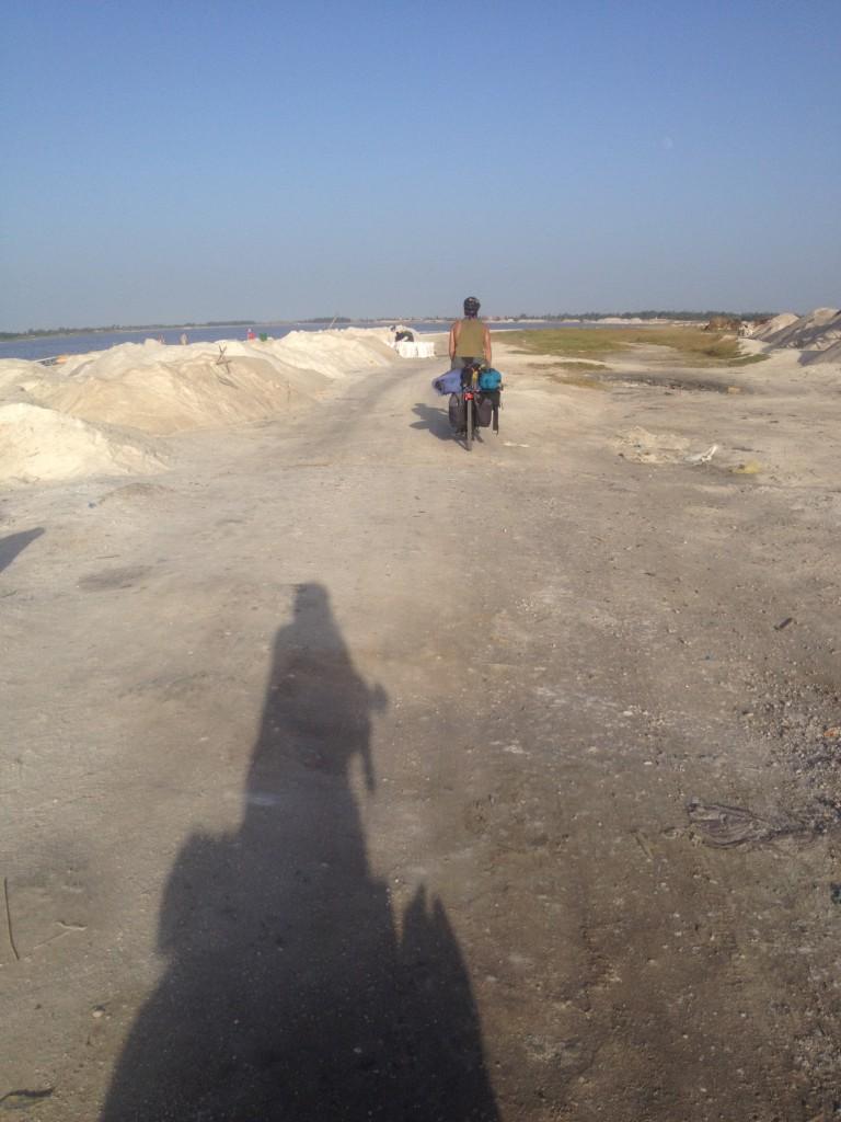 Biking through the salt mounds of Lac Rose