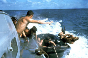 US_Navy_SEALs_SEAL_jumps_over_side_boat