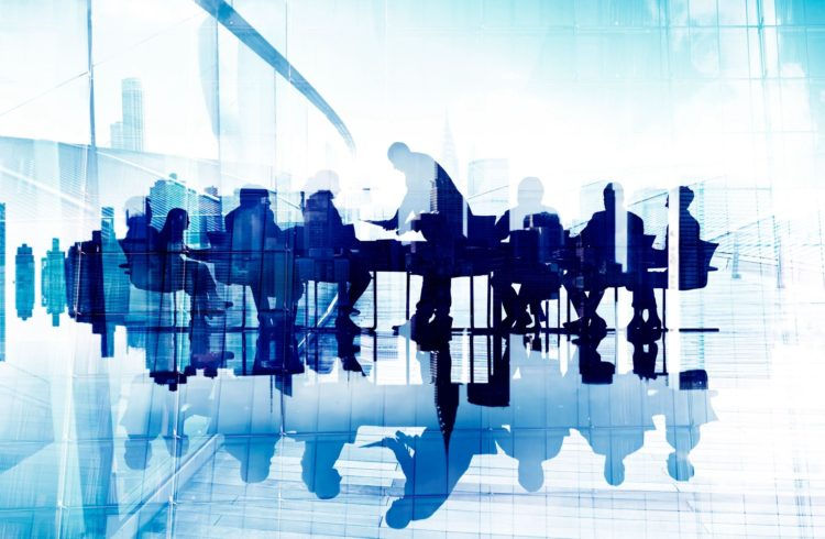 Abstract illustration of business people around a conference table.