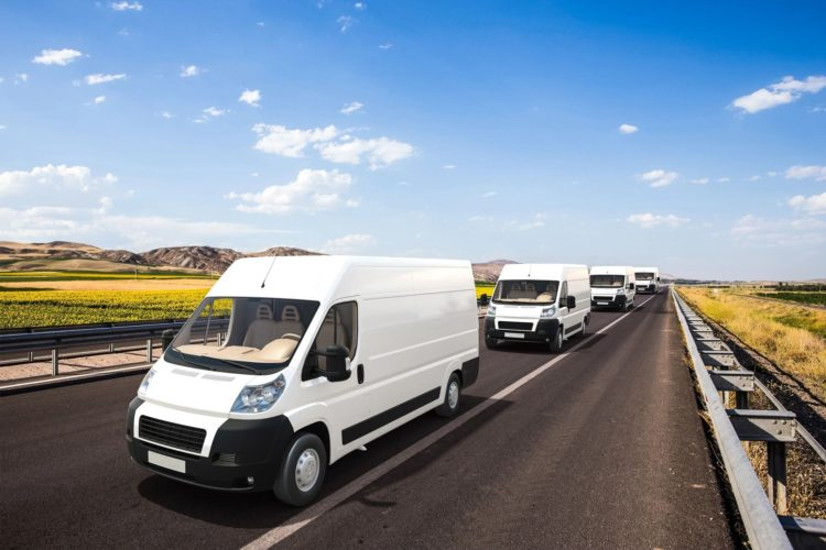 Delivery vans photographed on a roadway.