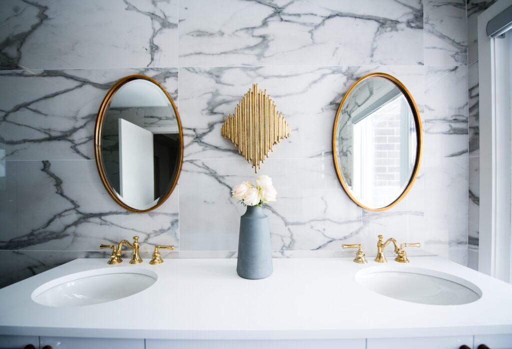 Use mirrors to brighten a dark bathroom