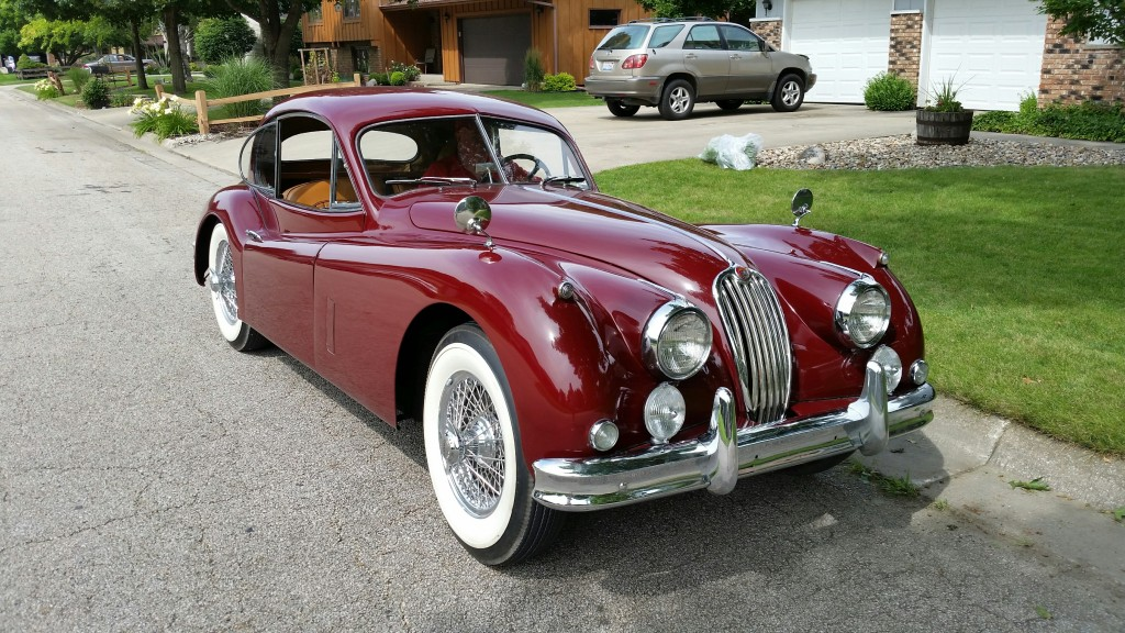 """Larry Philyaw - The XK140 is a 1956 survivor I found at an estate sale in a small town in PA. It was repainted in 1974 and interior refreshed, but otherwise is original. Also a great driver, I plan to do a """"rolling"""" restoration over the next couple of years."""