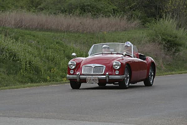 """Denny & LeeAnn Elimon, Mahomet, Illinois. 1961 MGA 1622, """"1 Lt-Red"""" Have owned the car since since 1992, She has traveled to numerous gatherings and shows, great family member. We have been British car enthusiasts for years! Have owned & enjoyed MGB's, MGTD's. MGBGT's & Midgets. Active members of the North American MGB & MGA Register organizations. Founding member of the Illinois Flat Land British Car Club, past Secretary of the North American MGB Register."""