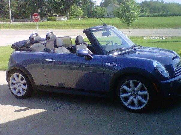 """Denny & LeeAnn Elimon, Mahomet, Illinois - 2006 Mini Cooper S Convertible. A true enjoyable top down travel car. """"Blue"""" has traveled state to state for English car events and national Mini events. Equipped with super charger & paddle shift transmission. Great adventure touring ride on the open roads of America."""