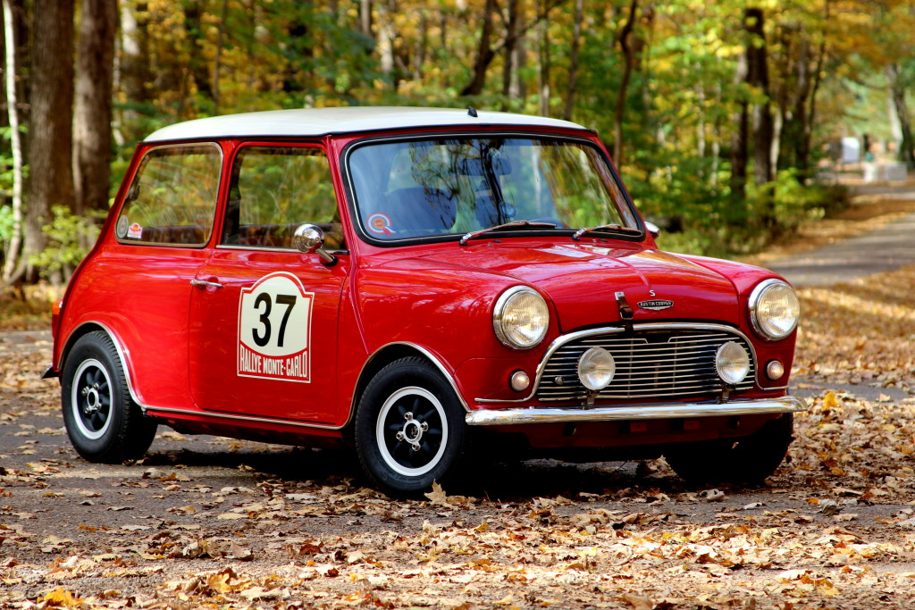 """Brian and Angie Davis - """"Paddy"""" - Is a Mk1 Austin """"Cooper S"""" replica, built from scratch using new and restored original Cooper S parts.. Paddy is registered as a 1973 Austin Mini. A 1380 cc A+ motor was built in 2010 by MinComp of California. The motor is fitted with twin 1.5"""" SUs, K&N cone filters, stub stacks and new spring needles. Red leather interior with adjustable leather seats. Instrumentation includes original Austin Cooper S gauges, 120 mph speedometer and Smith's tachometer."""