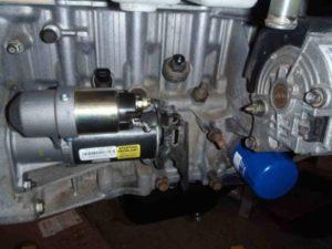 Car Starter Motor Mounted On Engine