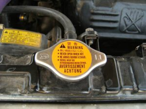 Radiator Cap With Overflow Hose Going On The Ground