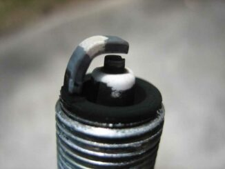 Carbon Deposits Building Up On Spark Plug