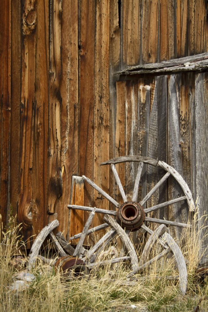 Wagon Wheels Against Old Barn