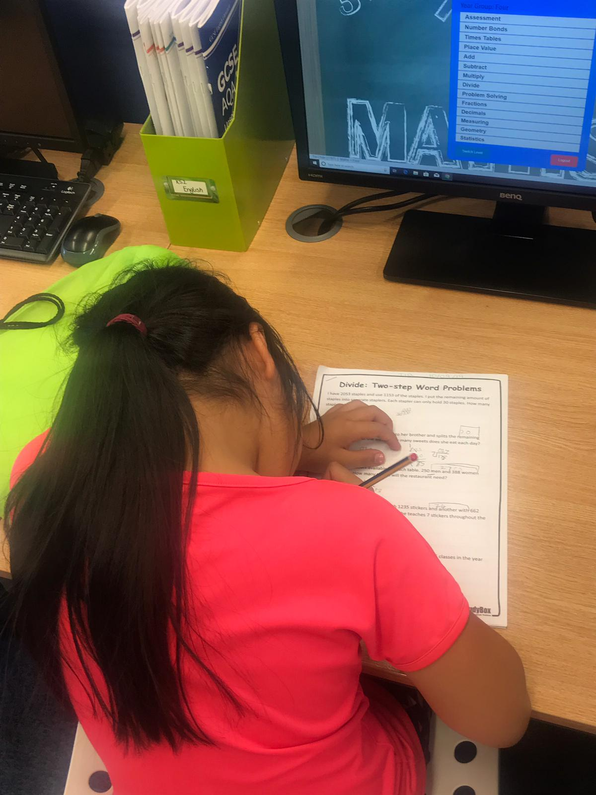 Image of a child studying at a desk.