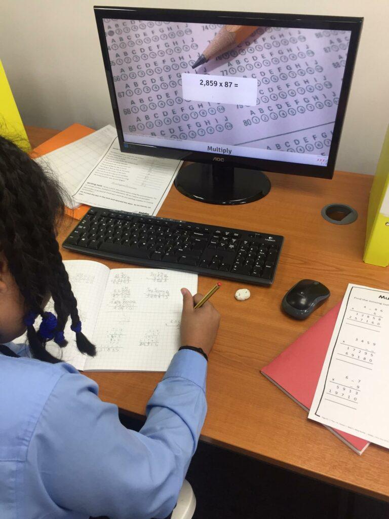 Child doing a maths equation.