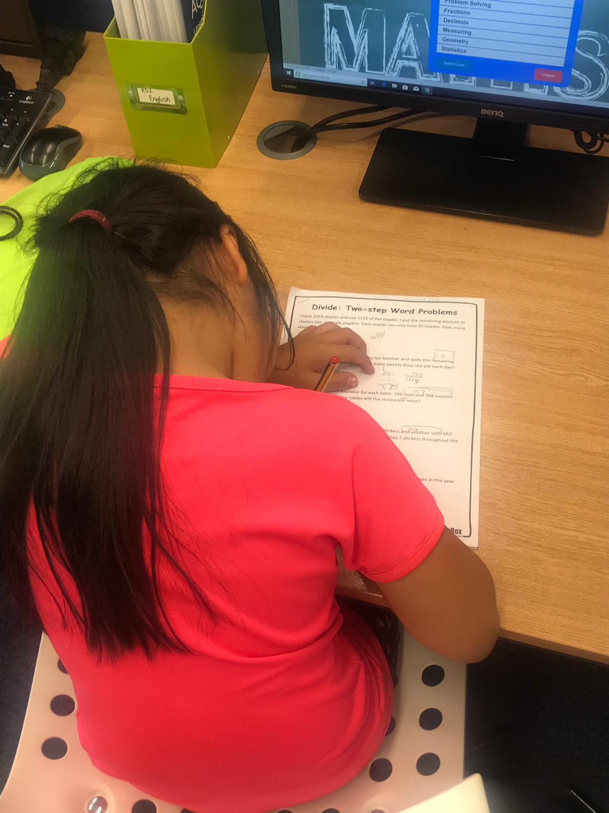 Image of a child completing schoolwork.