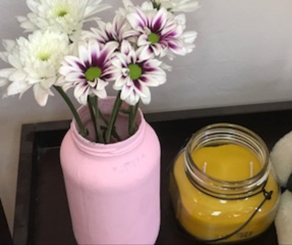 homemade candles on shelf