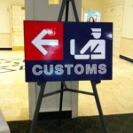 Travel Themed Bat Mitzvah - Sign for picking up passport place cards