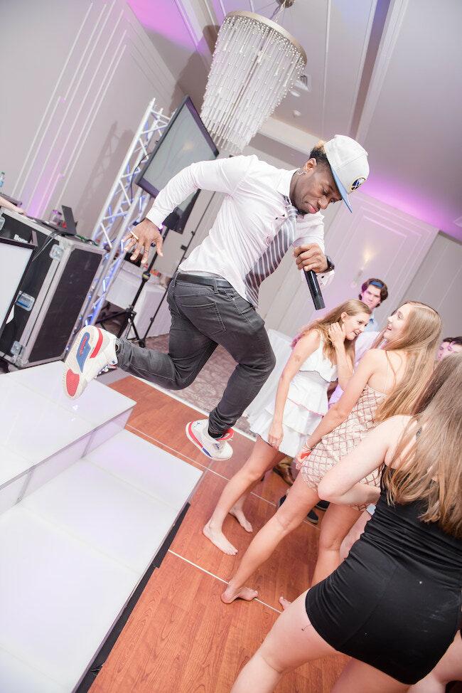 Lamar, the MC, leads the crowd