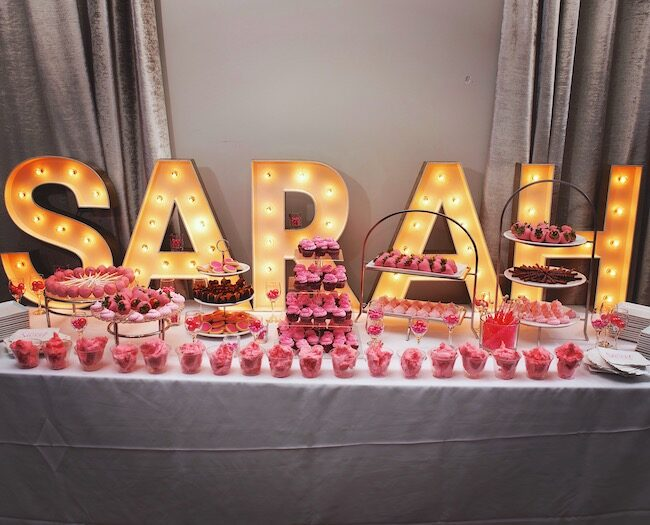 Dessert table backed by giant light-up letters