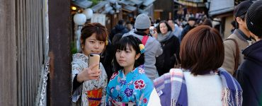 Visitors taking a selfie in Higashiyama, Kyoto