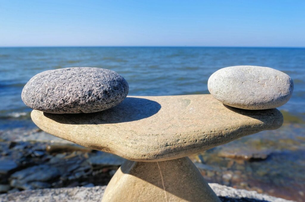Balancing rocks on the shore of a body of water