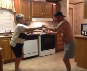 Son Grabs Mom's Hand When Their Favorite Song Comes On, Their Dance Is Lighting Up The Internet 1