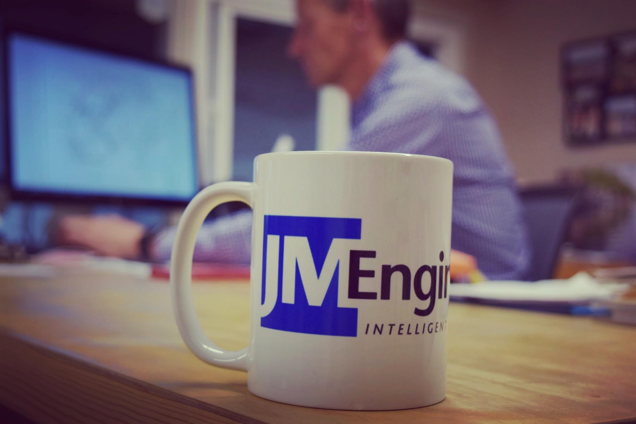 JM Engineering office John Melvin with mug