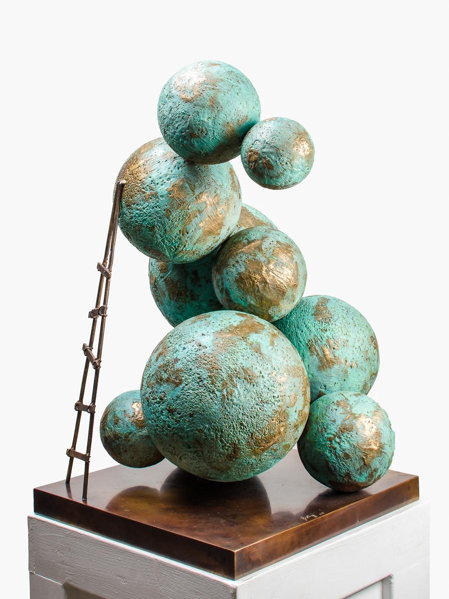 Climbing Worlds, bronze sculpture by Beatriz Gerenstein