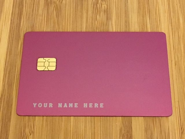 Pink metal credit card with name