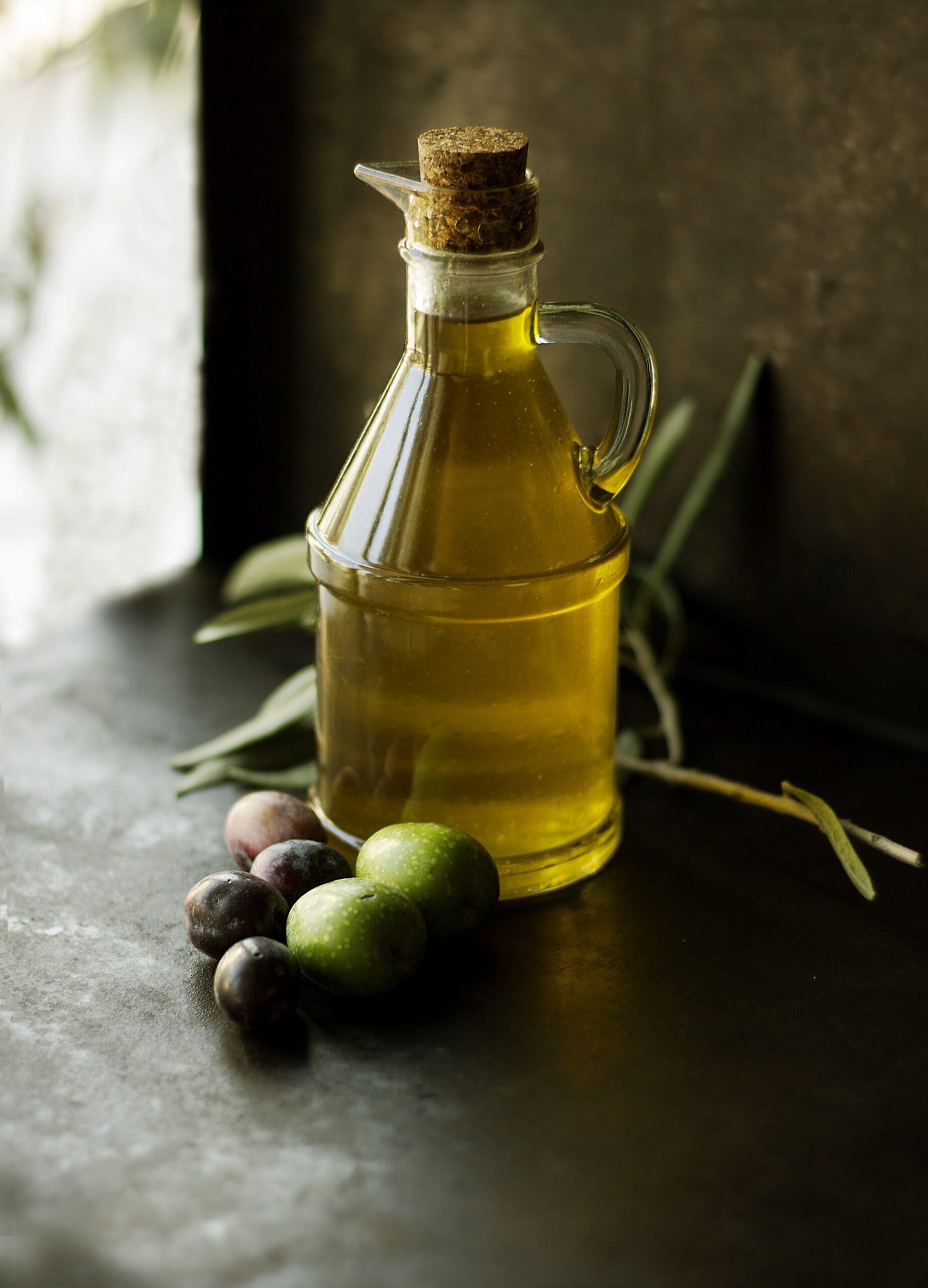 jar of olive oil with olives