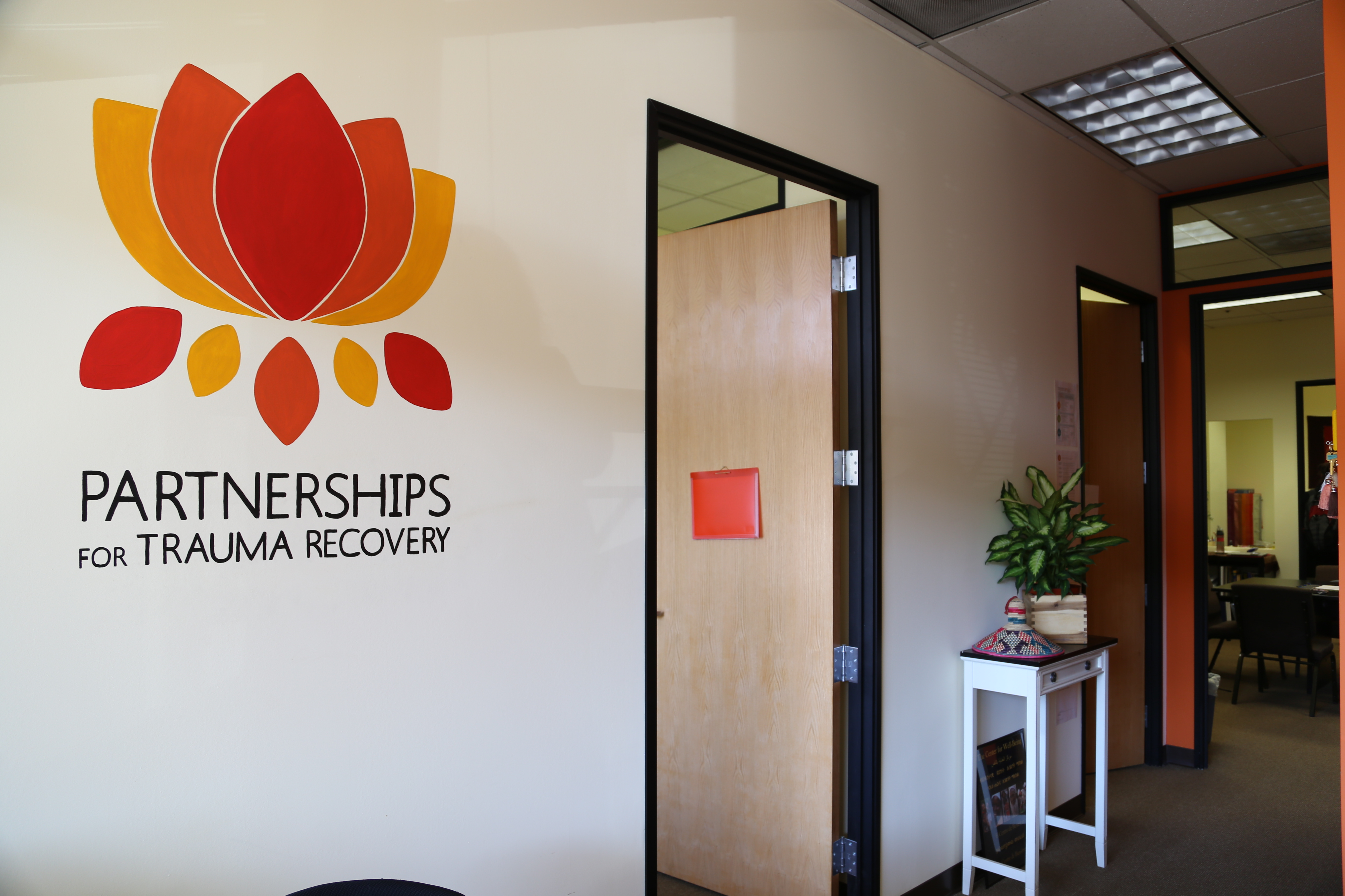 PTR office entrance in front of the wall with PTR's logo