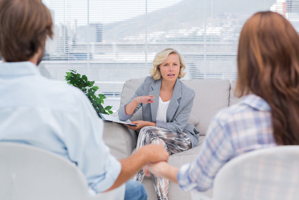 Therapist talking to a couple during a session