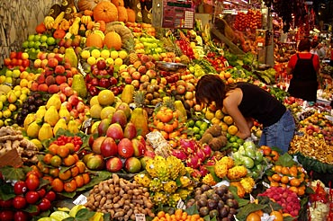 Western woman at market selecting from nutritious farm produce