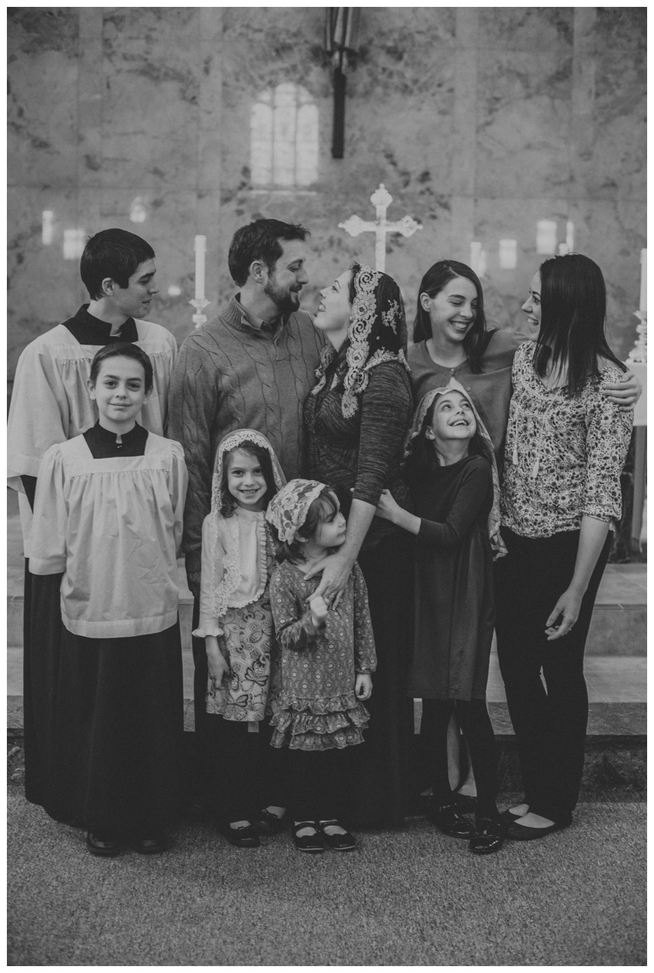 Catholic Family Laughing at Mass