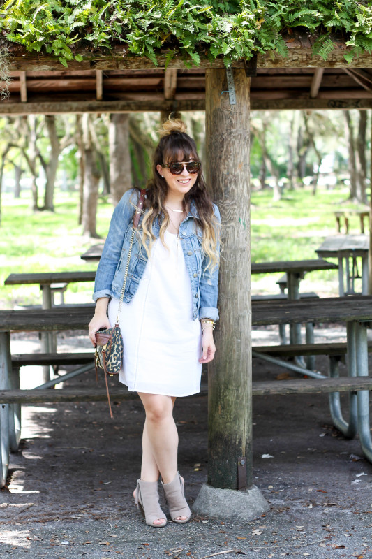 Old Navy white dress, J Crew Factory jean jacket, Rocksbox jewelry, Fantaseyes sunglasses, Kohl's fringe booties