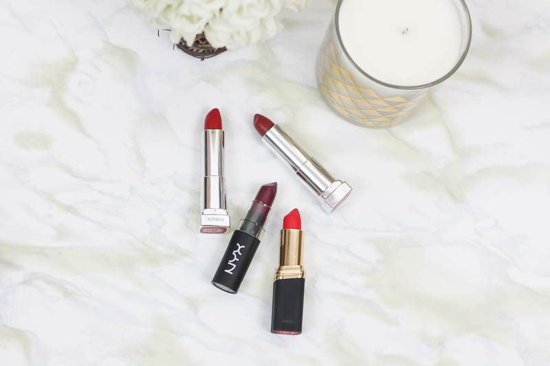 Miami beauty blogger Stephanie Pernas of A Sparkle Factor reviews 4 of the best red lipsticks from the drugstore