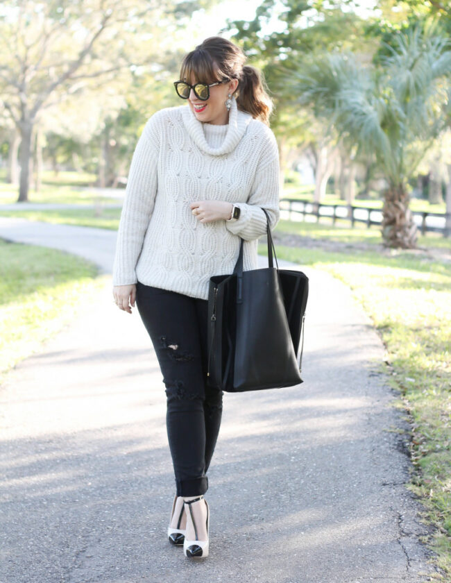 Turtleneck sweater, distressed black jeans, cap toe pumps